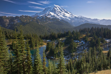View of Mount Rainier with a lake in the foreground