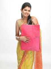 Teenage girl with pink shopping bag