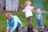 family near campfire poster
