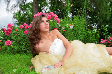 princess lying under rosebushes