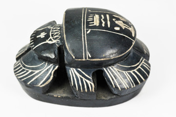 Ancient ritual egyptian scarab on a white background