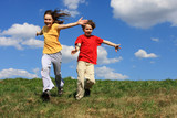 Fototapety Kids jumping, running against blue sky