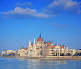 Hungarian Parliament standing by river in Budapest, Hungary poster