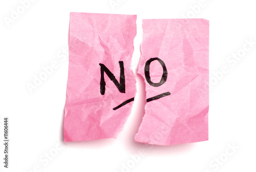 "Torn pink postit with ""no""."