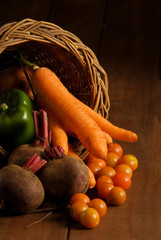 Thanksgiving cornucopia with autumn fruits and vegetables
