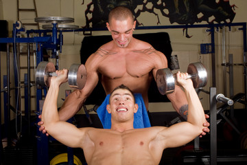 Two Bodybuilders training in the gym together