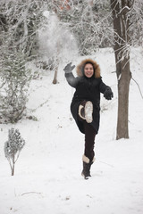 Happy girl throw out snow cake on a winter day, motion blur