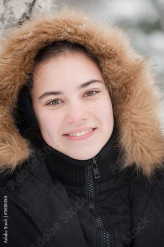 nice girl's face on a cold snow day