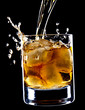 glass of whiskey and ice isolated over black background