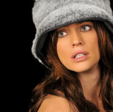 Beautiful Brunette Woman with Fuzzy Hat. poster