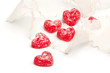 Red valentine hearts and ribbon on white background