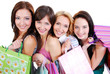 Happy cute smiling adult girls with shopping bags