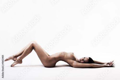 Nude brunette with fit fit body on the floor
