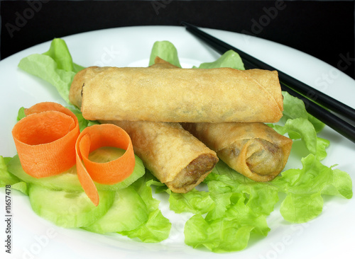 Plate of freshly fried vegetarian spring rolls