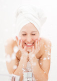 happy woman wash herself poster