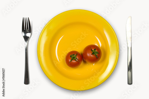 Ripe Tomatoes in yellow plate