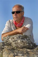 Handsome mature man adventurer posing outdoors