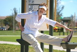 Mature woman exercising in the park