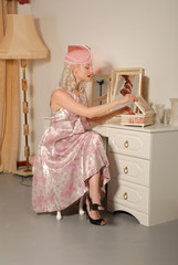 cute blond girl in fifties outfit at dressing table