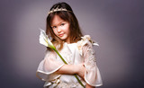 Little girl princess with flower