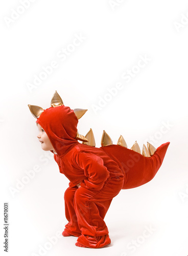 Happy child in dinosaur or dragon costume on white background