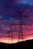 Sunset and a transmission tower on a hill poster