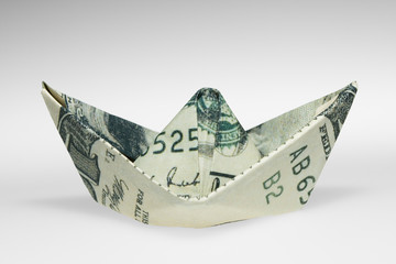 a banknote folded as ship