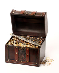 A wooden ancient chest full of money and a dagger