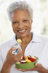 Senior Adult Eating A Fresh Fruit Salad