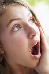 Portrait Of Teenage Girl Looking Shocked