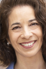 Portrait Of Middle Aged Woman Smiling At Camera