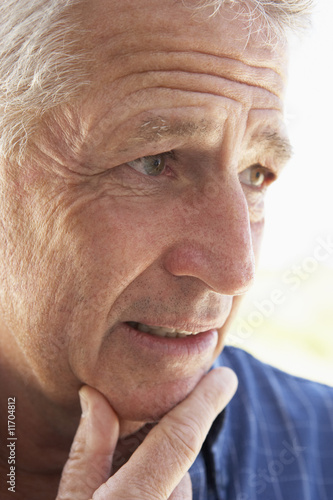 Portrait Of Senior Man Looking Anxious