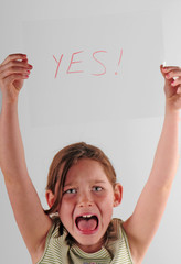 child holding YES sign