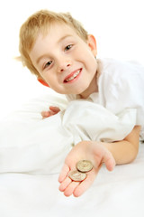 Young boy with a lost tooth, holding money from the tooth fairy