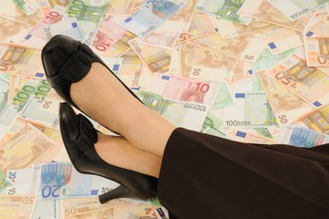 Business legs laid on money
