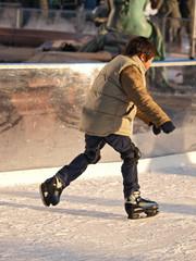 child learning  ice skating