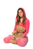 Young beautiful woman in the pink sportswear with teddy bear poster