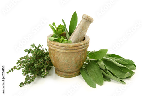 Mortar with herbs isolated on white background - 11736470