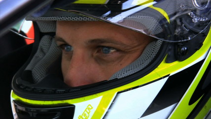 Concentrated glance of a racing driver