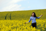 beautiful girl in a wild mustard field