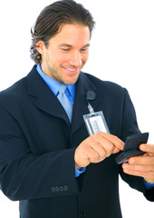 Happy Businessman Typing On Pager