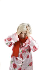 Headache senior woman