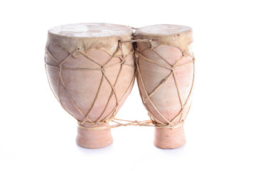 Terracotta bongo drums on a white background.