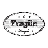Rubber office stamp with the word fragile poster