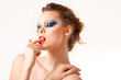 beautiful woman biting finger on white background
