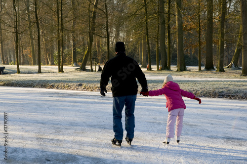 Father and daughter at the ice