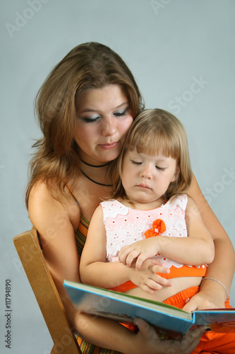 Two sisters read the book