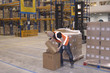 Warehouse worker packing boxes