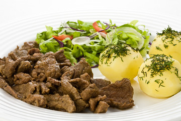 Grilled meat with boiled potatoes, sauce and vegetable salad