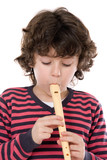 Adorable child playing flute